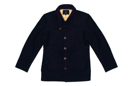 Lined woolen coat. Navy Blue color. Authentic styling. Choker style collar with knitted lining for extra warmth. Two deep lower pockets. Single breasted style.