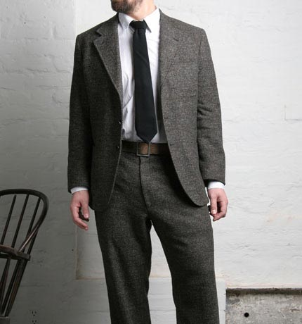 F.S.C. Three Button Suit - This suit style was traditionally worn in America in the 1940's. It has a softer shoulder, roomier body, and patch pockets. The pants are relaxed, have a high waist, and quarter top pockets. We recommend the pants be finished with a cuff.