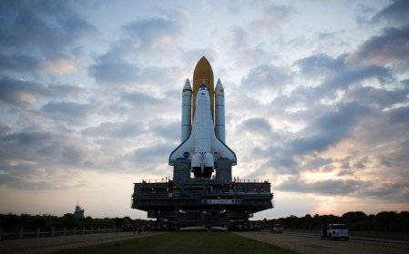 Space Shuttle Atlantis rolls atop the crawler transporter out to launch pad 39A at the Kennedy Space Center on March 31, 2009 in Cape Canaveral, Florida. (Matt Stroshane/Getty Images)